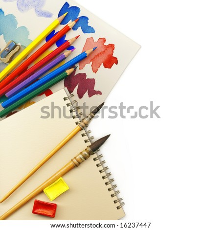Creative Art Background made of old paint brushes, albums, palette, colored pencils and other tools for drawing - stock photo