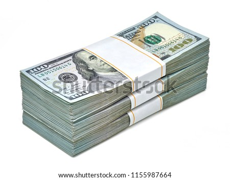 Creative business finance making money concept or stack of bundles of new design 100 US dollars 2018 edition banknotes or bills isolated on white background