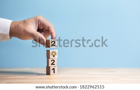 2021 Creativity and inspiration ideas concepts with hand person and text number on wood blog.Business inspiration
