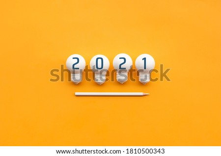 2021 Creativity and inspiration ideas concepts with lightbulb and pencil on color background.Business inspiration