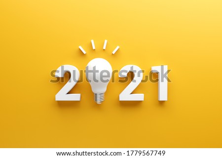 2021 creativity inspiration concepts, Light bulb idea with 2021 new year on yellow background, planning ideas.
