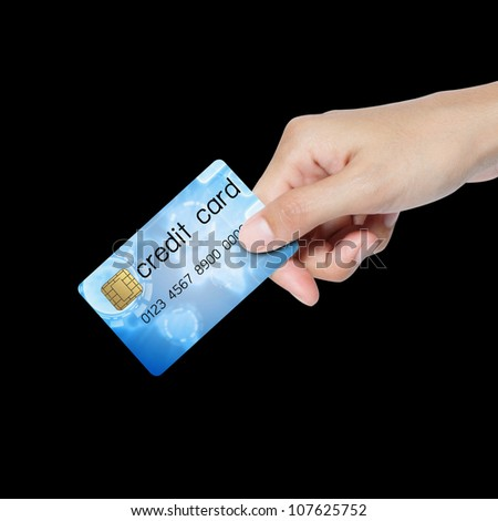 credit card holded by hand over blue background.