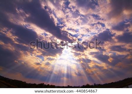 Shutterstock  crepuscular rays/It is dusk