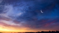 Crescent moon with beautiful sunset background . Generous Ramadan