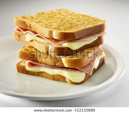 2 croque-monsieur sandwiches piled , on a white plate Photo stock ©