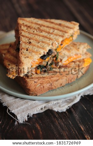croque monsieur with mimolette and mushrooms Photo stock ©