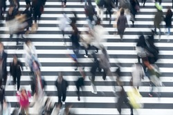 Crowds crossing the intersection of big city Tokyo