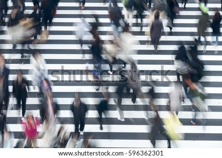 Photo of   Crowds crossing the intersection of big city Tokyo