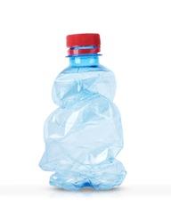 crushed plastic bottle on white background