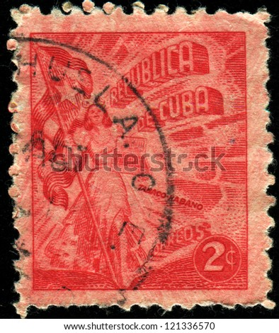 CUBA - CIRCA 1960: A stamp printed in Cuba shows  woman with Cuban flag, circa 1960 - stock photo