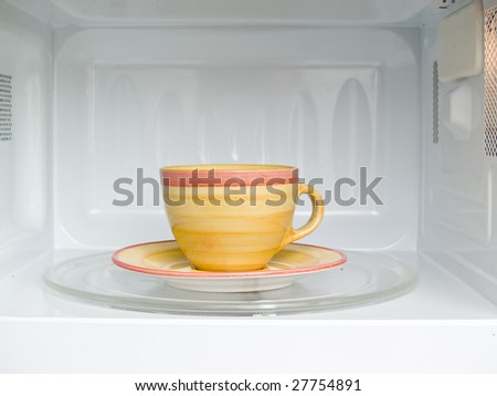 cup of coffee in microwave