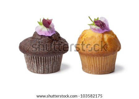 Cupcakes with fresh Sweet pea flowers on white background