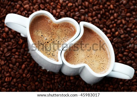 2 cups of coffee shape of heart and coffee beans - coffee time
