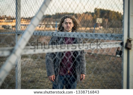 Curly guy. Curly guy on the sports field.  Curly guy on the playground