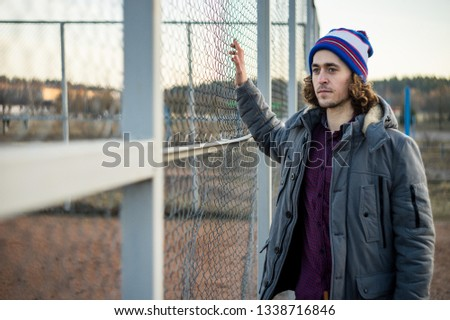 Curly guy. Curly guy on the sports field.  Curly guy on the playground. Curly guy in a hat