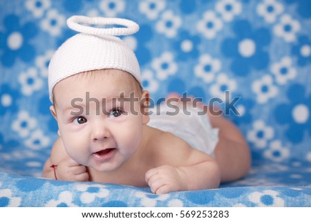 Cute Angel Baby On Blue Background 569253283