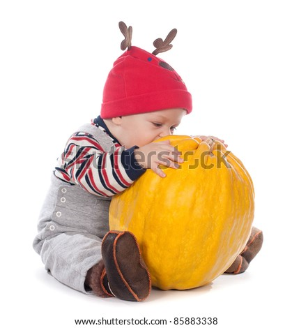 cute baby boy in funny deer hat with orange pumpkin on white background