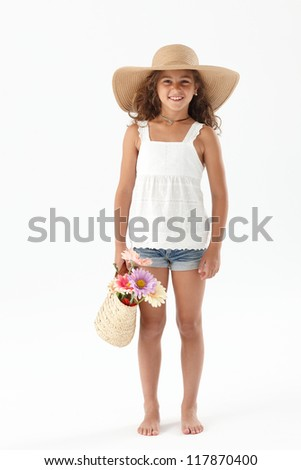 Cute girl holding a basket with flowers