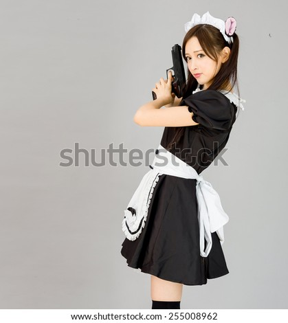 cute girl maid in gray background japanese style with gun