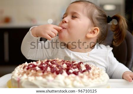 cute little girl eating cake