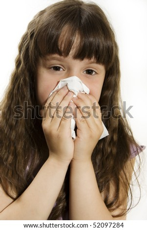 Cute little girl with the flu - isolated over white