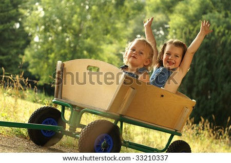 2 Cute little girls in a cart