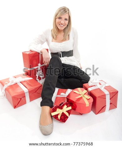 Cute young woman surrounded by packages, some of the heart shaped