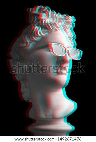 3d effect. Statue. Gypsum statue of Apollo's head. Man. Creative. Plaster statue of Apollo's white sunglasses. Head. Sculpture.  3D. Glitch Art. Apollo Belvedere