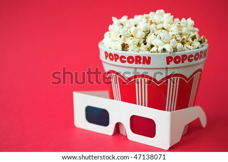 3D glasses & a bucket of popcorn - 3D cinema concept, shallow dof