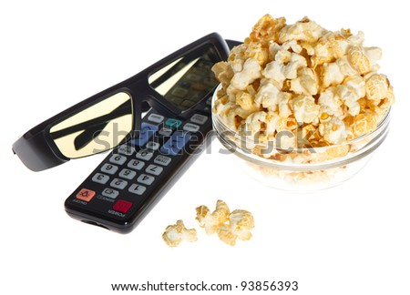 3d glasses, tv remote control and bowl with popcorn on white background