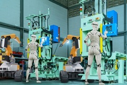 3D Humanoid robot working automated in factory futuristic modern tech, computer aided manufacturing. Future digital technology AI artificial intelligence in industrial factory production line concept.