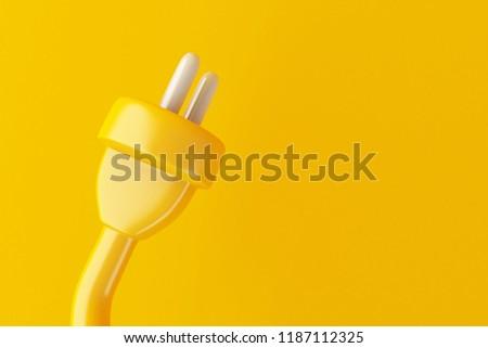 3d illustration. Electric plug on yellow background. Minimal concept.