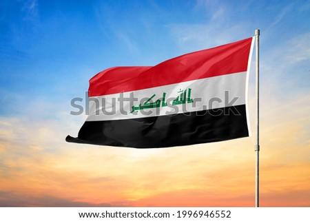 3D illustration flag of Iraq. Iraq flag on sky background.
