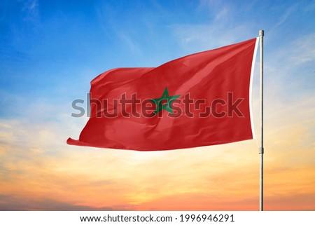 3D illustration flag of Morocco. Morocco flag on sky background.