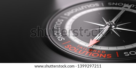3D illustration of a compass over black background with the text tailored solutions written in red. Made-to-measure services concept.  Stockfoto ©