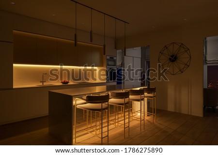 3D illustration of a kitchen with night lighting. Kitchen interior design with led island lighting. Kitchen design ideas 2020