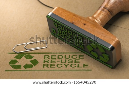 3D illustration of a rubber stamp with the text reduce, re-use and recycle printed on kraft paper. Reducing waste footprint concept. Foto stock ©