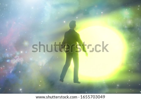 3D Illustration of a silhouete of a man with rays of light emanating  as a symbol of the power of thinking. Concept of psychiatry,  psychology, religion. Ghost of a man taken up into heaven Foto stock ©