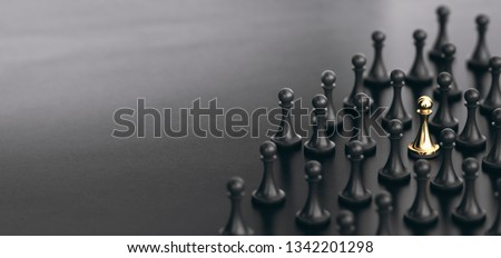 3D illustration of many pawns over black background plus a golden one. Concept of talent sourcing and spotted candidate