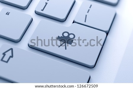 3d illustration of movie camera icon button on keyboard with soft focus