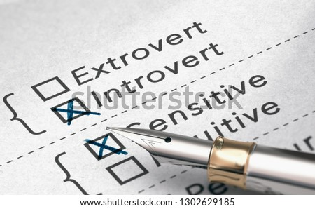 3D illustration of personality test with two words extrovert and introvert and a fountain pen.