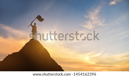 3D illustration silhouette of a businessman holding a flag on the mountain, the sky and the background of the sun light Business concept, success, leadership, success and people