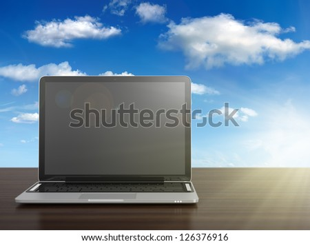 3D image of modern laptop with blank screen on wooden desk with blue sky on background