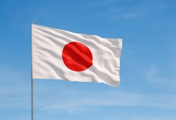 3d model of a waving Japanese flag. Blue sky background.