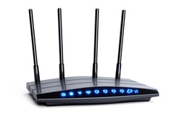 3d modern wireless wi-fi black router with four antennas and blue indicators isolated on white. High speed internet connection, firewall network and telecommunication technology concept. 2,4 and 5 ghz