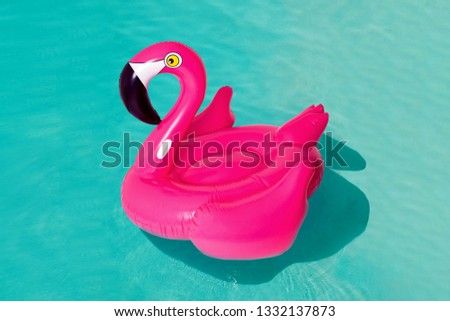 3d pink flamingo, tropical bird shape inflatable swimming pool ring, tube, float. Summer vacation holiday rubber object, traveling, beach ocean. Illustration isolated blue background #1332137873