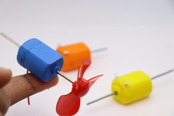 3D Printed Toy Dc Motor with Double Shaft. Two shaft motor having shaft at either sides