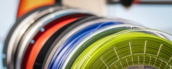 3D Printer Plastic filament for 3D printer and printed products in the interior of the design office