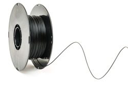 3D Printer Plastic Filament. Spool of black thermoplastic wire for 3D printing close up isolated on white background
