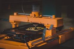 3d printer that printing a liquid dough. 3D printer printing pancakes with liquid dough different shapes close-up. Modern additive technologies 4.0 industrial revolution